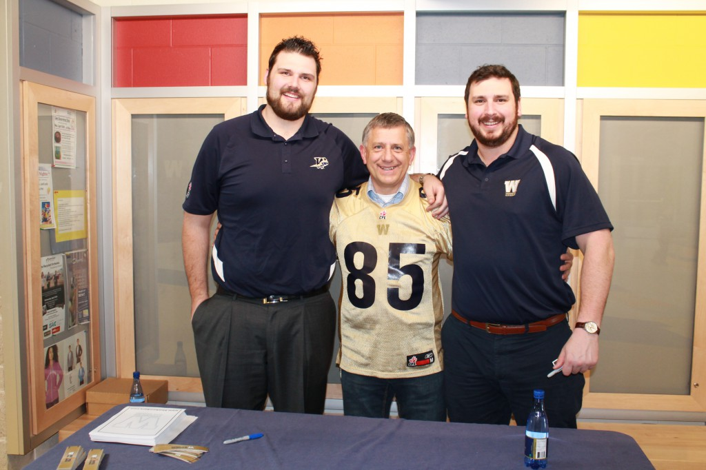 MP Ted Falk with Bombers Paul Swiston and Glen January